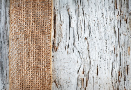 Old rough wooden background with sacking ribbon Stock Photo - 20824379