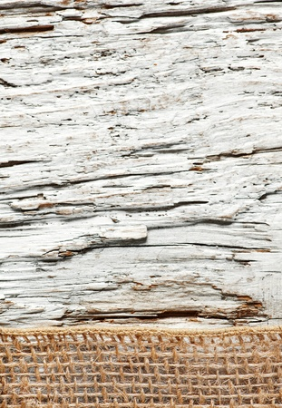 Old rough wooden background with sacking ribbon photo