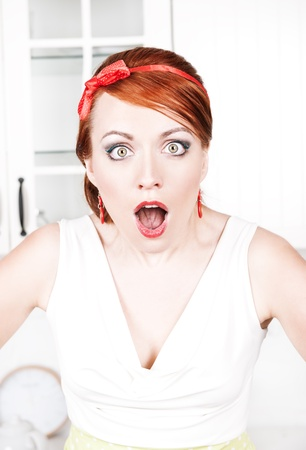 Surprised beautiful woman with red hair  photo
