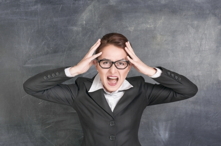 Screaming teacher on the school blackboard background Stock Photo - 20897486