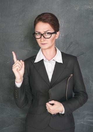stringent: Strict teacher Stock Photo