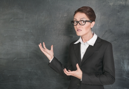 stringent: Crazy teacher on the school blackboard background Stock Photo
