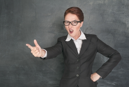Angry screaming teacher on the school blackboard background Stock Photo - 21145740