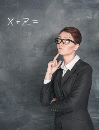quandary: Teacher in glasses solving equation