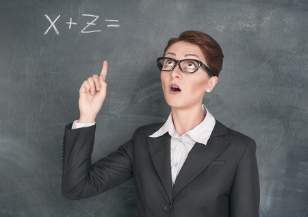 Teacher in glasses solving equation photo