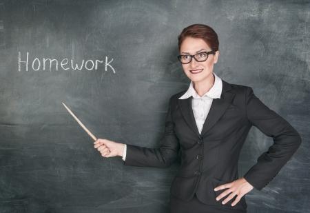 stringent: Crazy teacher with pointer and phrase Homework on blackboard chalkboard
