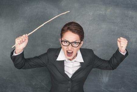 angry teacher: Angry screaming teacher with wooden stick