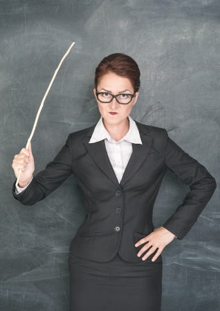 Angry teacher with wooden stick photo