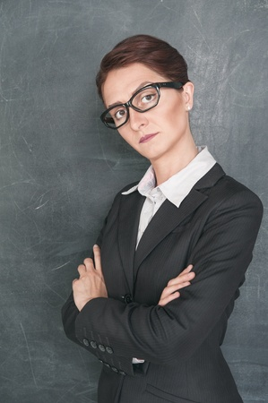 stringent: Strict teacher on the school blackboard background