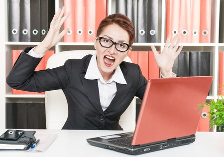 Angry screaming business woman in glasses