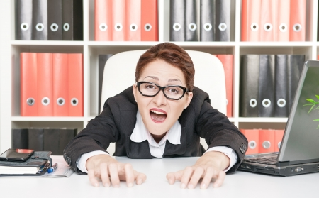 Crazy screaming business woman in glasses photo
