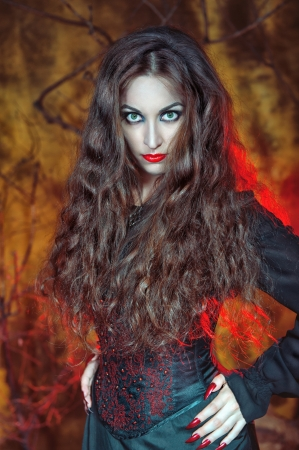 Beautiful halloween witch with long hair