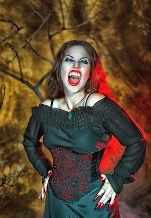 Screaming halloween beautiful vampire with long hair Stock Photo