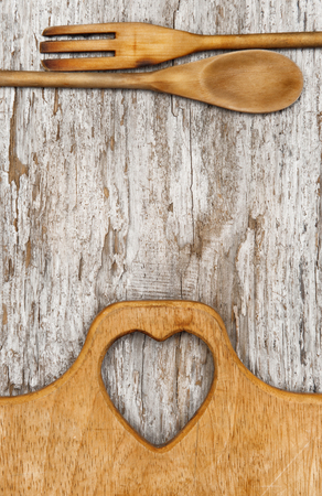 Kitchen utensils on the old wood rustic background photo