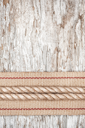 Rope and hardware burlap ribbon on the old wood photo