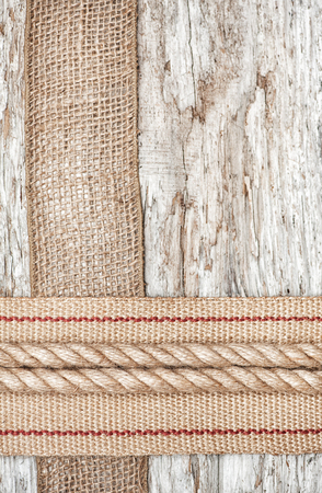 Rope and hardware burlap and sacking ribbon on the old wood photo