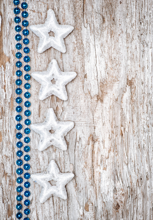 Christmas background with star shape and chaplet on the old wood photo