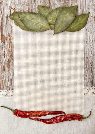 Canvas, spices and linen fabric on the old wooden background photo