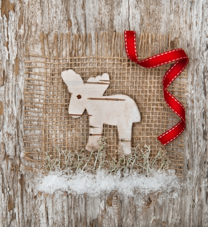 Christmas deer made of birch bark on the burlap photo