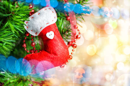 Christmas background with red sock on fir tree photo