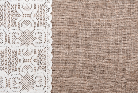 brown flax: Burlap background and white lacy cloth
