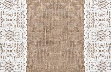 burlap sack: Burlap background and white lacy cloth