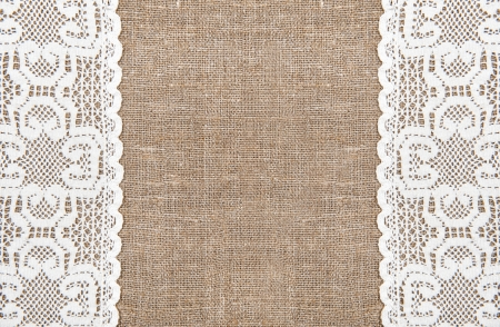Burlap background and white lacy cloth