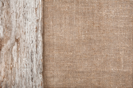 Burlap background bordered by rude old wood
