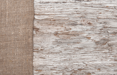 Old wood bordered by burlap background