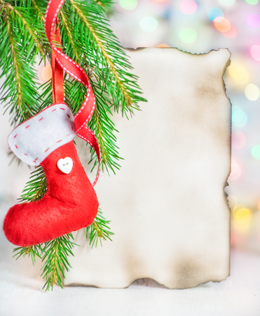 Christmas card with red sock on fir branch and abstract bokeh background Stock Photo - 24237006