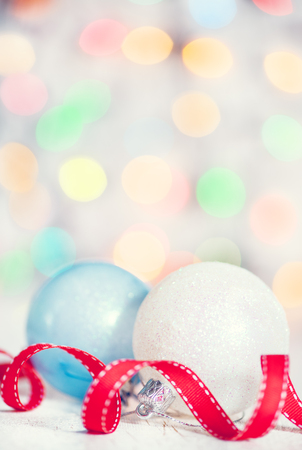 Christmas background with red ribbon and balls on abstract bokeh background photo