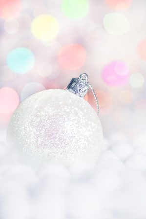 Christmas ball on abstract bokeh background  photo