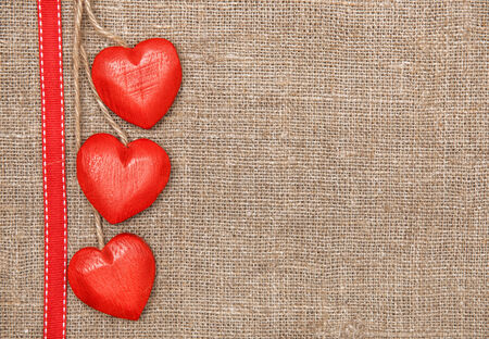 Wooden hearts on the burlap  photo