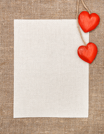 Valentine card with wooden hearts and canvas on burlap  photo