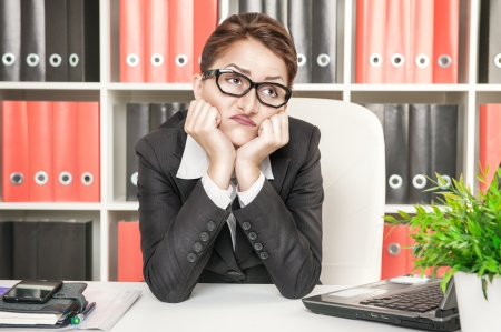 inattentive: Boring business woman working at office
