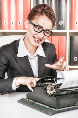 Crazy screaming business woman in glasses working with typewriter Stock Photo - 24680183