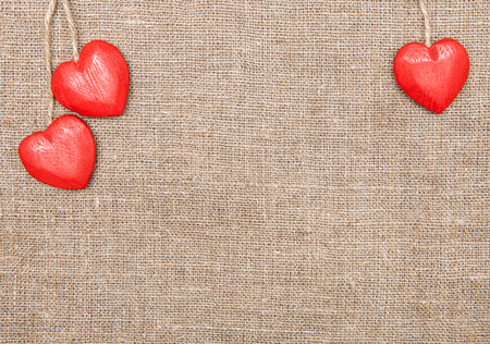 Wooden red hearts on the burlap photo
