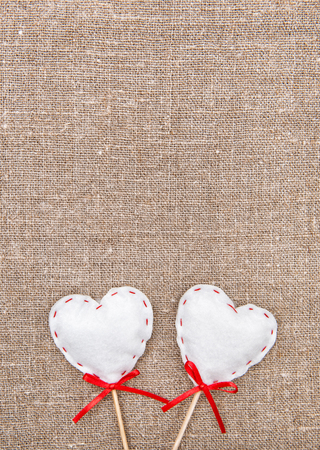 Textile hearts on the burlap  photo