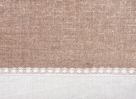 Burlap background and white linen lacy cloth