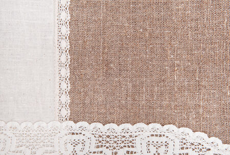 bagging: Burlap background with white lacy and linen cloth Stock Photo