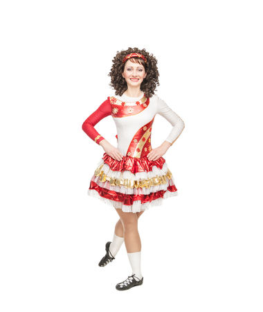 Young woman in irish dance dress and wig posing isolated photo