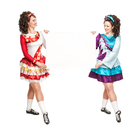 Irish dancers with empty paper on the white background photo