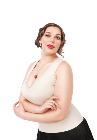 Beautiful  plus size woman posing on white background photo