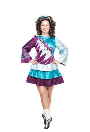 Young woman in irish dance dress posing isolated photo