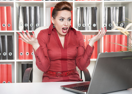 Angry screaming business woman working with computer Stock Photo - 25845416