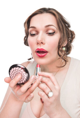 Beautiful plus size woman applying lipstick with mirror isolated photo
