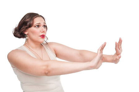 renounce: Beautiful plus size woman making refuse gesture isolated