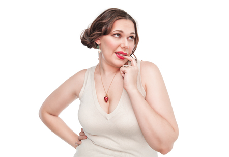 Sexy beautiful plus size woman posing on white background photo