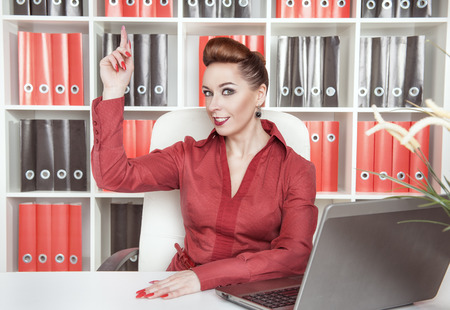 irradiation: Beautiful business woman having idea working at office Stock Photo