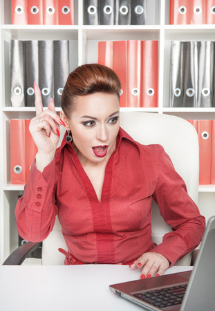 Beautiful business woman having idea working at office photo